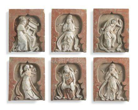 A GROUP OF SIX PAINTED POTTERY FIGURAL TILES