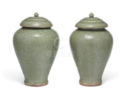 A PAIR OF CARVED LONGQUAN CELADON VASES AND COVERS