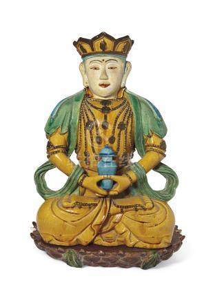 A RARE LARGE OCHRE, GREEN, TURQUOISE AND AUBERGINE-GLAZED SEATED FIGURE OF AMITAYUS