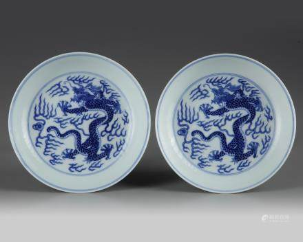 A pair of Chinese blue and white 'dragon' dishes