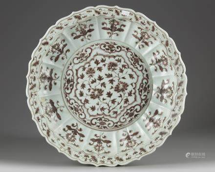 A Chinese Ming-style underglaze copper-red-decorated 'floral' charger