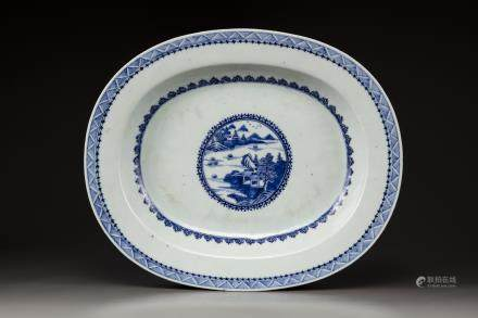 A large blue and white oval platter