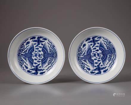 A pair of Chinese blue and white 'phoenix' dishes