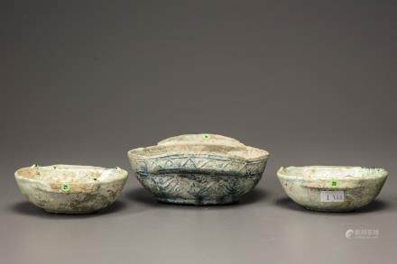 Three green glazed pottery ear cups