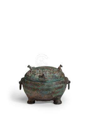 AN ARCHAIC BRONZE RITUAL TRIPOD VESSEL AND COVER, DING   Warring States period, 5th/4th century B.C.