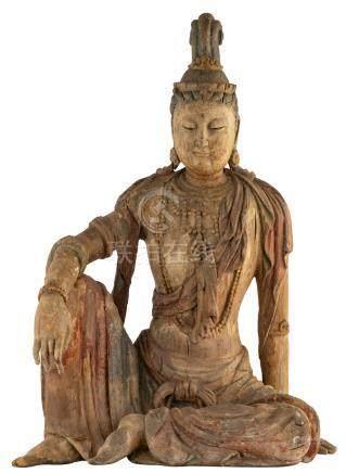Guanyin Pusa (Sk. Avalokitesvara) sits in dawang youxizi (Sk. Maharajalilasana), posture of royal ease.
