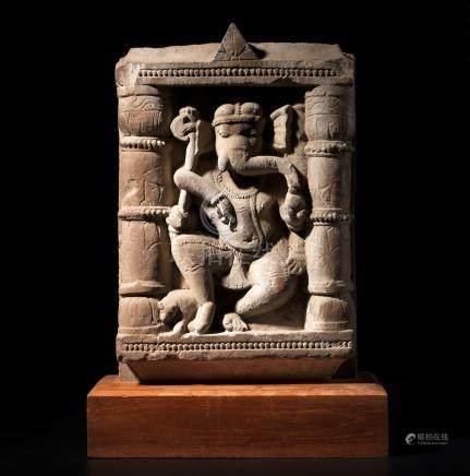 A BUFF SANDSTONE PANEL OF DANCING GANESHA NORTH INDIA, CIRCA 10TH CENTURY
