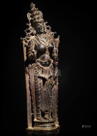 A COPPER ALLOY FIGURE OF DEVI SOUTH INDIA, KERALA, 16TH CENTURY