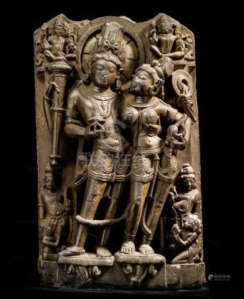 A BLACKSTONE STELE OF LASKHMINARAYANA NORTH INDIA, 10TH/11TH CENTURY