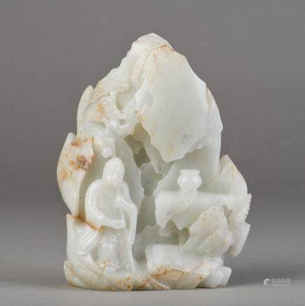 A WHITE JADE CARVED BOULDER