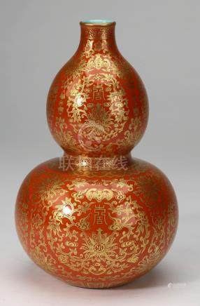Chinese iron red and gilt double gourd vase