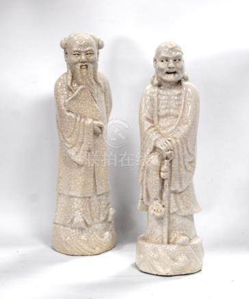 Pair of crackle glazed figures, Lohan and Shou Lao, 22cm high. (2)