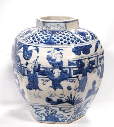 Large hexagonal blue and white vase decorated with oriental scenes, 31cm high.