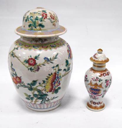 Famille rose jar and cover decorated with blossom, 22cm high, and another, smaller, with armorial