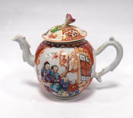 Canton teapot and cover with floral finial and decorated with traditional scenes, 15cm high.