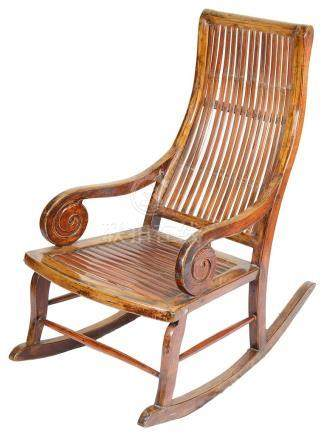 A 19th Century Chinese Rocking Chair: With carved spur scrolls to the sides and bamboo slat seat,