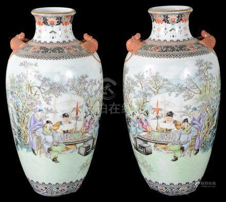 A Pair of Chinese Vases: Depciting figural garden scenes with seated officials reading scrolls.