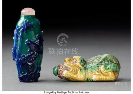 A Chinese Glass Overlay Snuff Bottle and Porcelain Fu Lion Snuff Bottle, late Qing D...