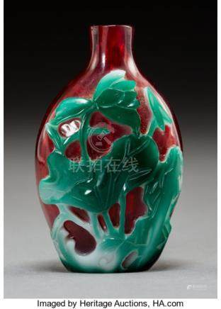 A Chinese Three-Color Glass Overlay Snuff Bottle, Qing Dynasty. 2-1/2 x 1-1/2 inches (6.4 x 3.8