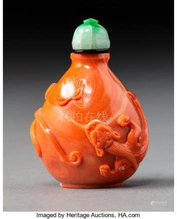 A Chinese Carved Coral Dragon Snuff Bottle. 1-7/8 x 1-1/4 x 1 inches (4.8 x 3.2 x ...