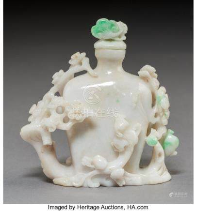 A Chinese Carved Jadeite Snuff Bottle. 3-1/2 x 3 x 1-3/4 inches (8.9 x 7.6 x 4.4 cm). ...