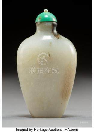 A Chinese White Jade Snuff Bottle, Qing Dynasty. Marks: (insized Qianlong seal). 2-1/2 x 1-1/2