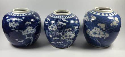 A GROUP OF THREE CHINESE 'PRUNUS' PATTERN BLUE AND WHITE GINGER JARS, TWO WITH FOUR CHARACTER MARK
