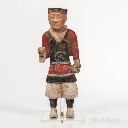 Tomb Pottery Warrior, China, standing with hands positioned to hold weapons in military costume, wi