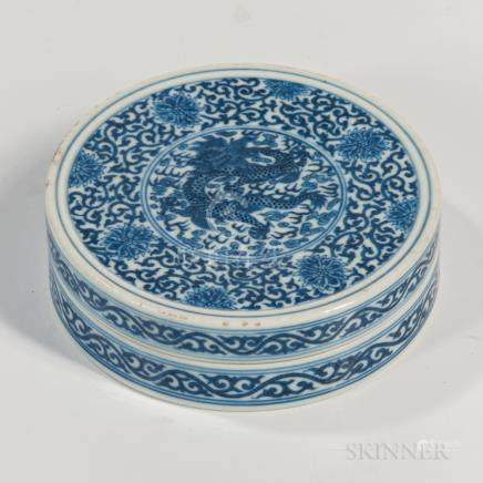Blue and White Covered Box, China, 19th century, circular form decorated with a dragon-and-cloud in