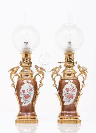 A pair of oil lamps