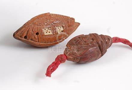 A Chinese peach stone carving as a junk boat, with bone inset detail, length 4cm; together with