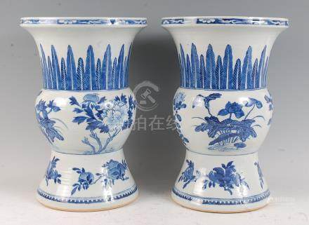 A pair of Chinese export blue and white vases, the flared necks each painted with stiff leaves,