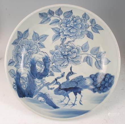 A Chinese export blue and white bowl, of good size, decorated with peacocks in a landscape, with six