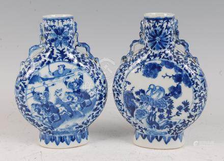 A pair of Chinese export moonflasks, each underglaze blue decorated, one with opposing reserves of