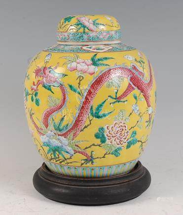 A Chinese export yellow ground ginger jar and cover, the whole enamel decorated with four-claw