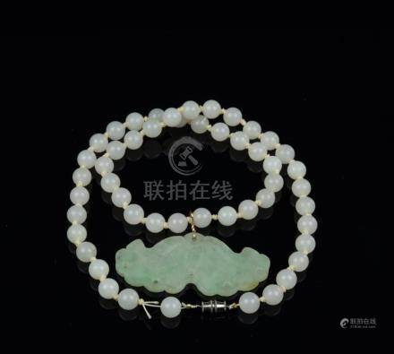 A Jadeite Pendant and 50 Beads Necklace
