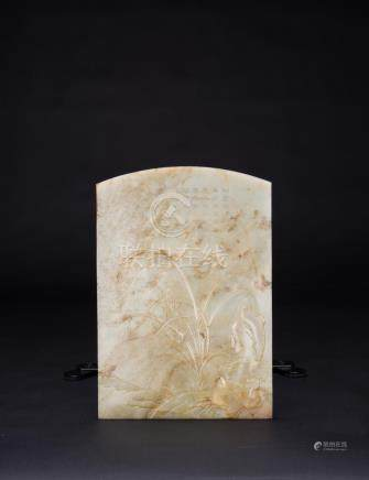 Qing- A White Jade Carved 'Orchid and Rock' With Imperial Po