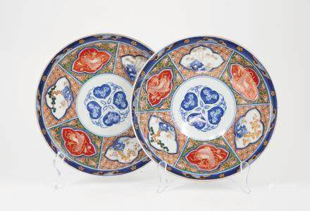 Pair C19th Imari Plates slight curved rim and foot with traditional panel decorations. under glaze