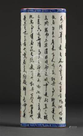 Chinese porcelain wrist rest, in the form of a scroll, the text followed by the cyclical date