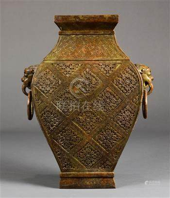 Chinese bronze hu vase, of rectangular section molded with a floral diaper pattern, flanked by