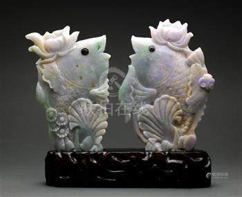 Pair of Chinese of jadeite fish, each topped with a lotus blossom on its head, and set into one wood