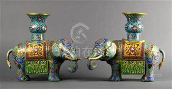 Pair of Chinese cloisonne enameled vessels, each of a carparisoned elephant supporting a gu-vase