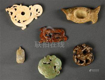(lot of 6) Chinese archaistic hardstone carvings, including a fish with a well to the center; a