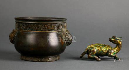 (lot of 2) Chinese bronze items: the first, a mythical beast with traces of gilt; the second, a