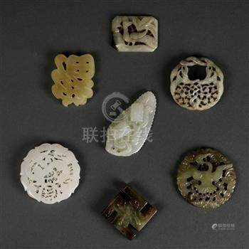 (lot of 7) Chinese hardstone toggles and plaques, including a pierced 'fu' character; three