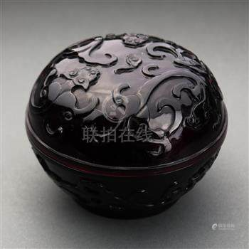 Chinese Peking glass circular box, of aubergine hue carved with meandering chilong to the