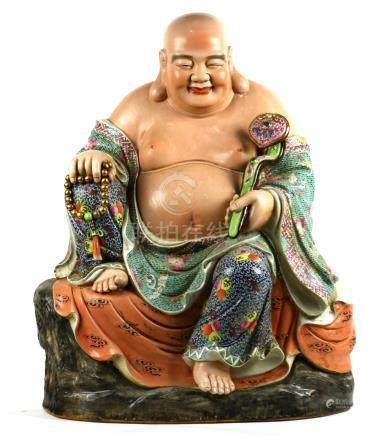 Chinese enameled porcelain Budai, seated in royal ease holding a ruyi scepter and a strand of prayer