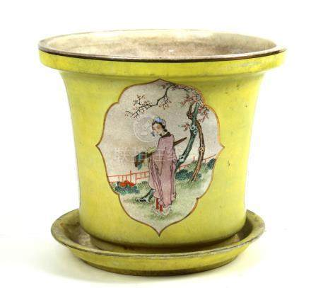 Chinese porcelain yellow ground planter, featuring two reserves with a beauty holding a qin,
