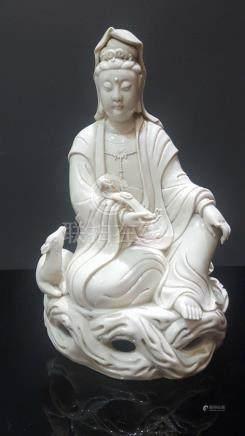 Blanc de Chine. Kwan In. Chine. XIXème.       H : 30 cm.  Manques dont un doigt