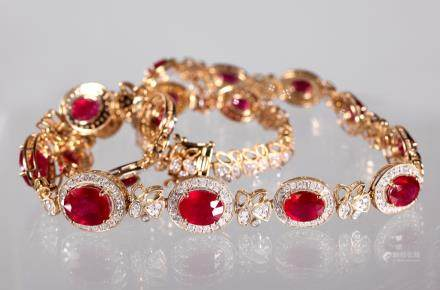 AIG Certified; 17 Oval Cut Rubies; 14K Necklace